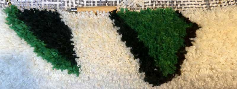 """Die Messe Veggienale & Fairgoods, """"Nordwolle"""", spinnen und Teppich knüpfen."""
